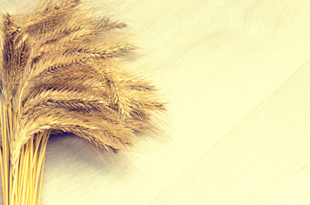 tailings: ears of wheat on wooden background Stock Photo