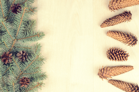 stuffer: branches of blue spruce and cones on a wooden background Stock Photo
