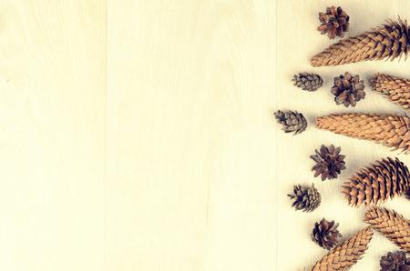 stuffer: various fir cones on a wooden background