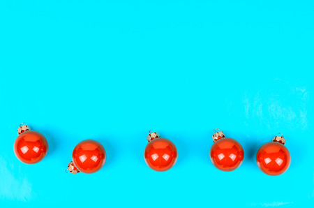 stuffer: five red Christmas balls on a contrasting blue background