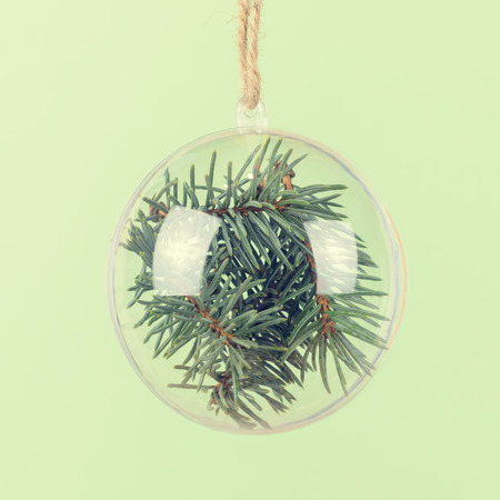 stuffer: Transparent Christmas ball with a blue spruce inside. Сhristmas background