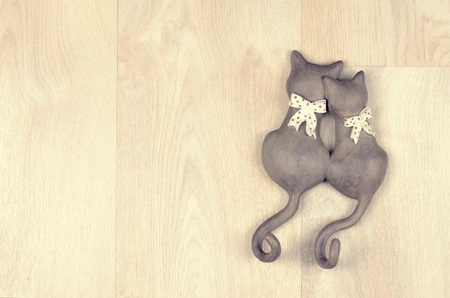 enamored: clay toy enamored cats on  a wooden background