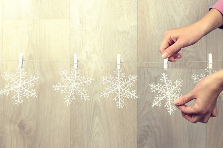 stuffer: Woman hand creating christmas decoration indoor