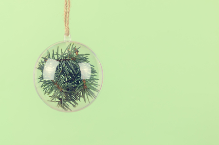 hogmanay: Transparent Christmas ball with a blue spruce inside. Сhristmas background