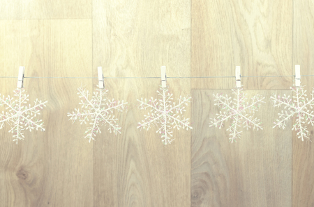 creating christmas decoration indoor. christmas background with snowflakes