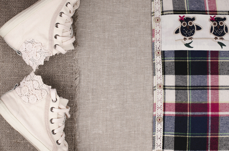 needle lace: Womens sneakers and plaid shirt with lace insertion. Trendy lace insertion.