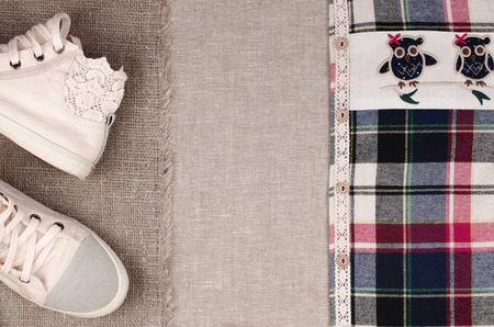 insertion: Womens sneakers and plaid shirt with lace insertion. Trendy lace insertion.