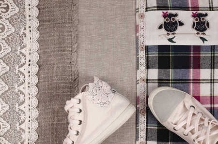 insertion: Womens sneakers  and plaid shirt with lace insertion. Trendy lace insertion. Stock Photo