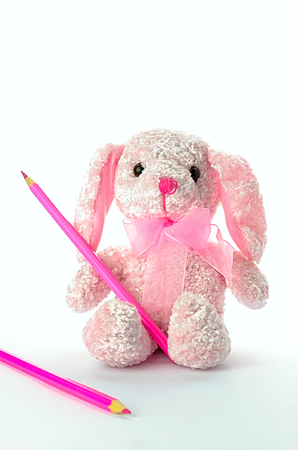 girlish: girlish soft toy with a pencil on a white background Stock Photo