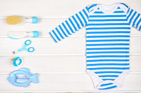 Baby accessories on white wood background