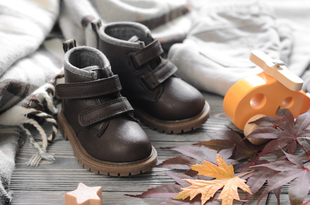 Fashion brown leather kids shoes, denim pants and accessories. autumn concept