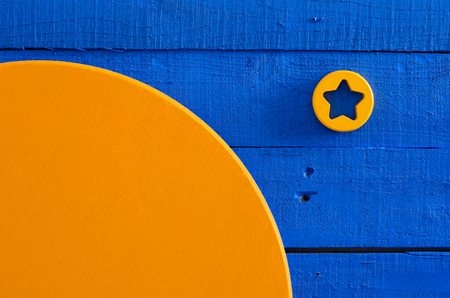 wood painting, wood crafting, blue and orange saturated colors. Abstract wooden background with simple geometrical shapes (circle, star). minimalism, abstract space consept Standard-Bild - 95300346