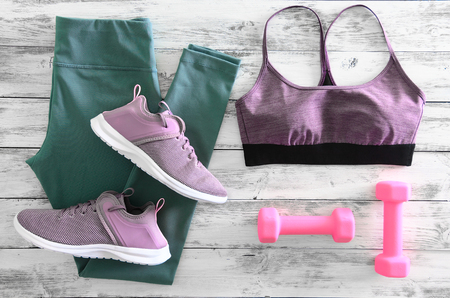 Womens active clothes (leggings, bra) footwear (sneakers) and  equipment (pink dumbbells). Active lifestyle concept, Flat lay Standard-Bild - 95969053