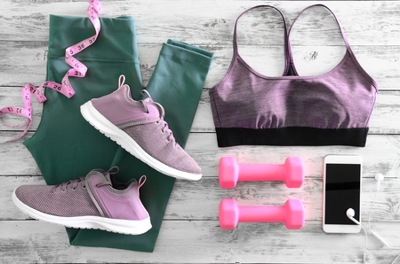 Womens active clothes (leggings, bra) footwear (sneakers) and  equipment (pink dumbbells, tape measure). Active lifestyle concept, Flat lay Standard-Bild - 95961536