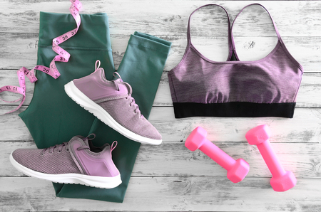 Womens active clothes (leggings, bra) footwear (sneakers) and  equipment (pink dumbbells, tape measure). Active lifestyle concept, Flat lay Standard-Bild - 96012470