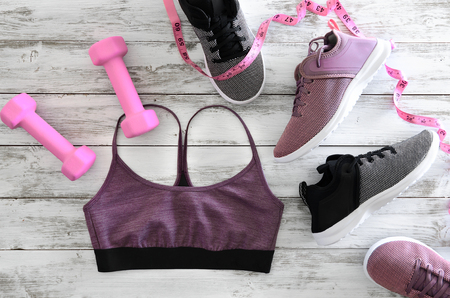 Womens clothes (sport bra), footwear (sneakers) and  equipment (pink dumbbells, tape measure). Active lifestyle concept, Flat lay Standard-Bild - 95995916