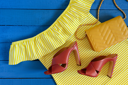 Womens clothing, accessories, footwear (yellow dress,  leather terracotta heel shoes,  crossbody bag). Fashion outfit. Shopping concept. Flat lay. Trendy, saturated colors. Spring summer collection Standard-Bild - 97373205