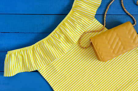 Womens clothing, accessories (yellow dress,  crossbody bag). Fashion outfit. Shopping concept. Flat lay. Trendy, saturated colors. Spring summer collection Standard-Bild - 97399725