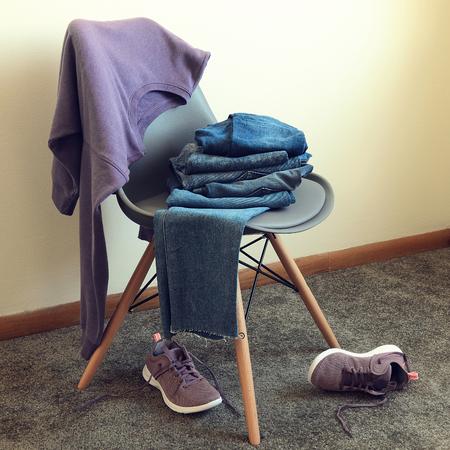 Womens clothing, footwear (violet sweatshirt, jeans, sneakers). Outfit for teens. Wardrobe. sport, casual style. Trendy colors Standard-Bild - 97503683