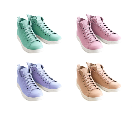Four pastel colors (mint green, lavender, beige, pink) of women shoes isolated on white background. Fashion footwear, spring summer collection Standard-Bild - 97528442