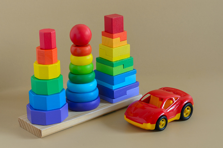 Learning developmental kids toys.  Geometric stacker, toy car. Copy space Standard-Bild - 97612127