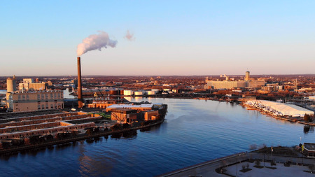 Aerial view of city at dawn. Industrial cityscape. Milwaukee, Wisconsin, USA.  Industrial pollution, emissions