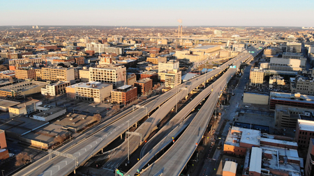 Aerial view of american city at dawn. High-rise  buildings, freeway, bay.  Sunny morning. Milwaukee, Wisconsin, USA