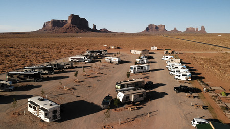 Utah, United States - July 9, 2018: RV park (campground) near the Oljato–Monument Valley, Utah. Aerial view, from above, drone shooting. Arizona - Utah border. Sunset