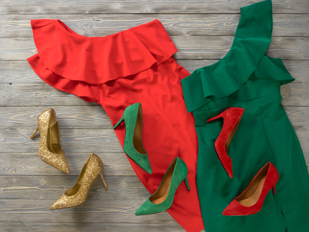 Womens clothes and shoes (Red green dresses, pumps). Fashion outfit for christmas, evening, night out. Template for online store, website, banners. Flat lay, top down view Standard-Bild - 109731687