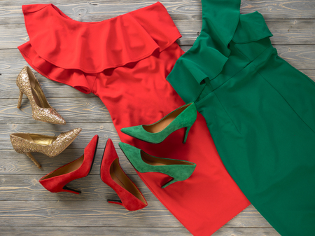 Womens clothes and shoes (Red green dresses, pumps). Fashion outfit for christmas, evening, night out. Template for online store, website, banners. Flat lay, top down view