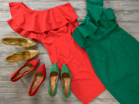 Womens clothes and shoes (Red green dresses, pumps). Fashion outfit for christmas, evening, night out. Template for online store, website, banners. Flat lay, top down view Standard-Bild - 109731690