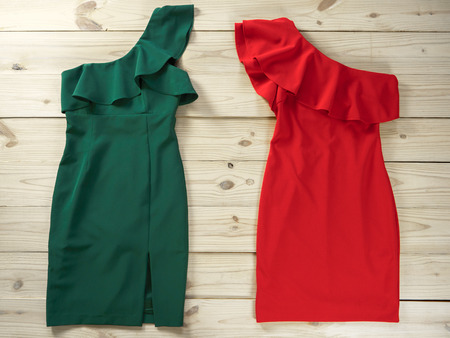 Womens clothes (Red green dresses). Fashion outfit for christmas, evening, night out. Template for online store, website, banners. Flat lay, top down view