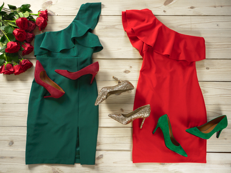 Womens clothes and shoes (Red green dresses, pumps). Fashion outfit for christmas, evening, night out. Template for online store, website, banners. Flat lay, top down view Standard-Bild - 111298361