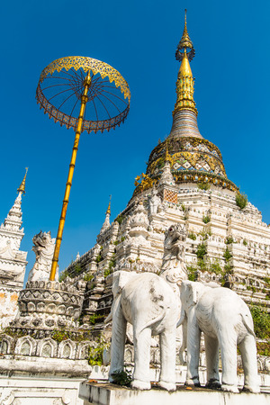 umbrela: Stupa at  Wat Saen Fang temple in Chiang Mai, Thailand.  Ancient construction of public property Stock Photo