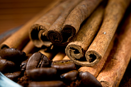 Close up of  cinnamon and coffee heap. Selective focus. photo