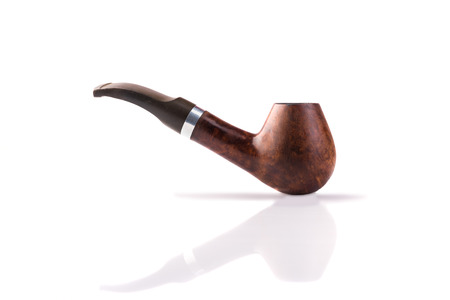 Vintage brown tobacco pipe with reflection  isolated in white background Stock Photo