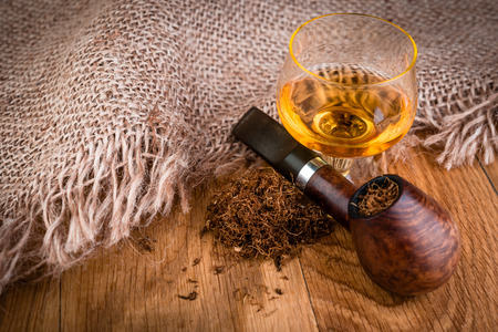 cognac: smoking pipe and  cognac on vintage style