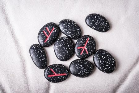 futhark: runes of natural stones  on white sheepskin