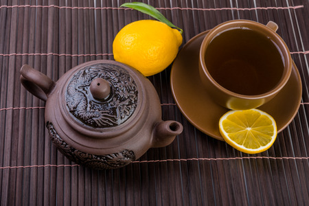 chinese tea pot: chinese tea pot  and cup of tea with  lemon