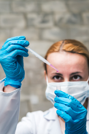 biomedical: Scientist holding container with suspension of stem cells for cryopreservation. Cell culture for the biomedical diagnostic.