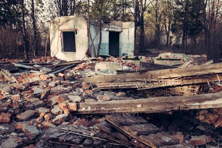 home destruction: Old abandoned destroyed house Stock Photo