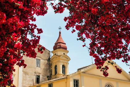 kerkyra: Old greek church in flowers bougainvillea, Kerkyra, Greece, selective focus