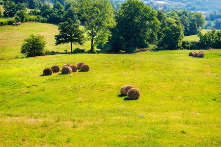 toskana: Tuscany landscape with haystacks, Italy. Stock Photo