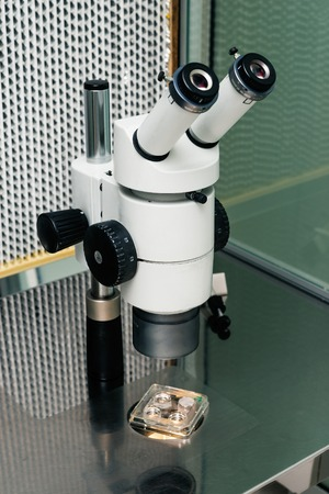 reproductive technology: microscope for in vitro fertilization process close up.  Equipment on laboratory of Fertilization, IVF. Stock Photo