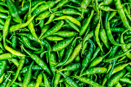 Green chili peppers, natural food  background