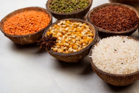 cereals, seeds, beans, grains in a bowls on white table