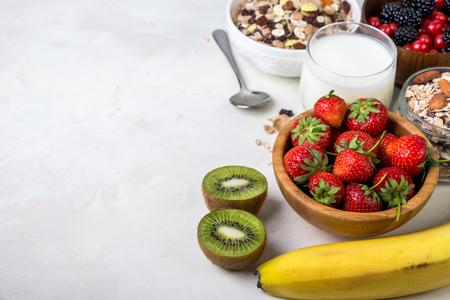 Granola with strawberry and kiwi. Healthy breakfast. 写真素材
