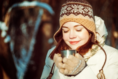 thermos: Portrait of a beautiful young woman Stock Photo