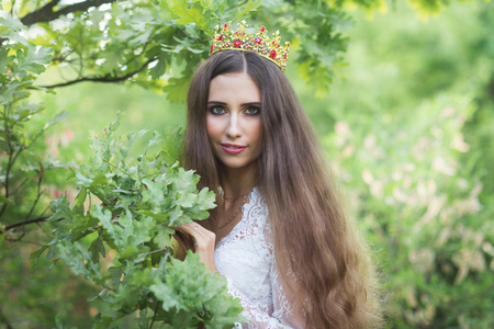 beautiful girl. fantasy young woman in woods