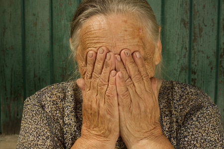 cries: 86 years old grandmother   covered his face with hands and cries